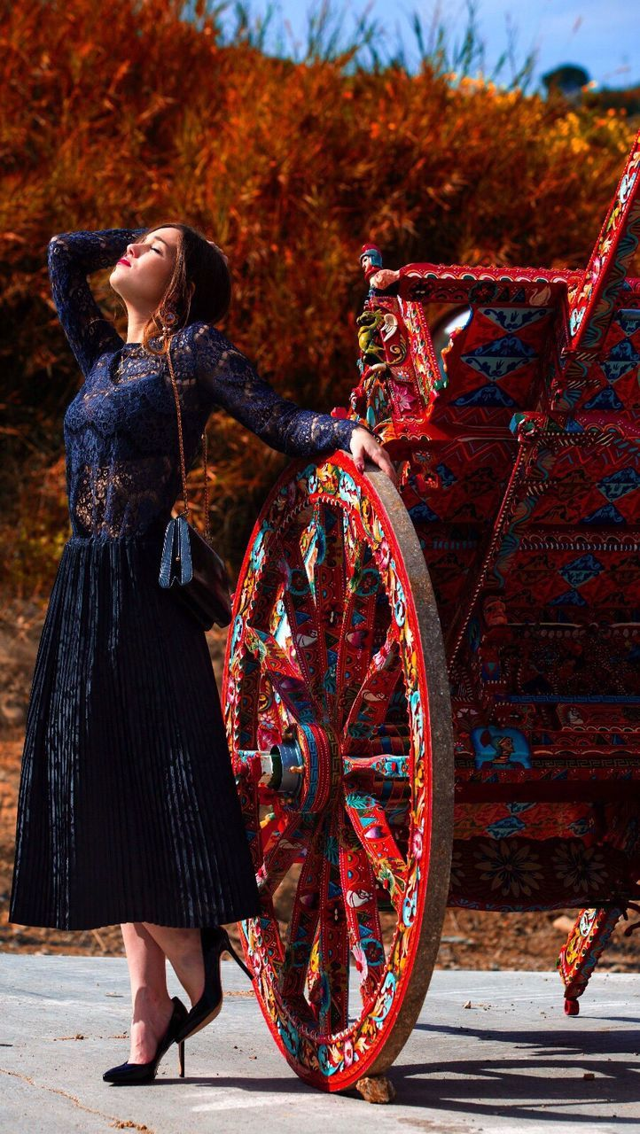 only women, autumn, one woman only, full length, fashion, adults only, one young woman only, adult, one person, young adult, arts culture and entertainment, outdoors, young women, multi colored, people, women, tree, beautiful woman, day