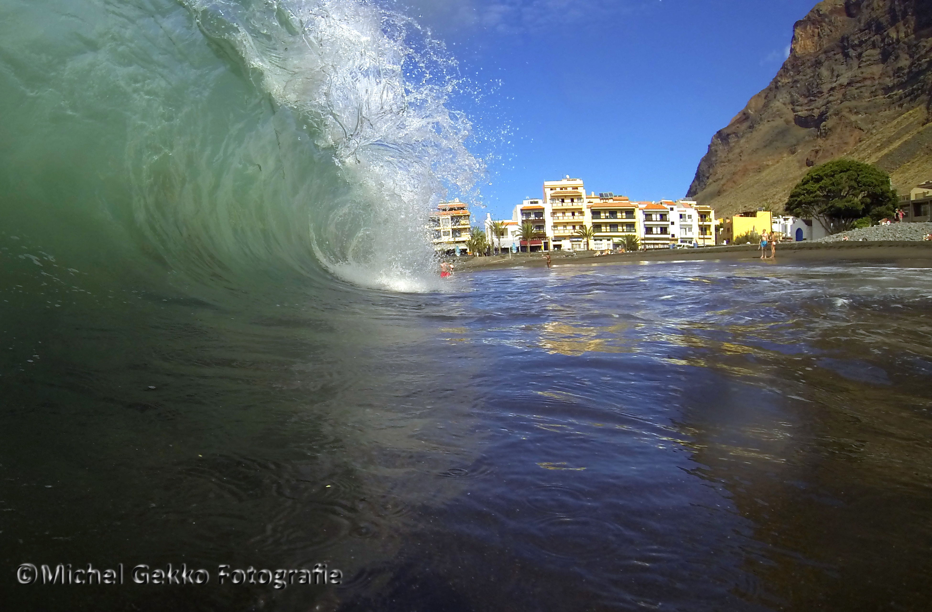 water, sea, building exterior, beach, waterfront, wave, architecture, built structure, motion, surf, splashing, shore, nature, sky, reflection, scenics, incidental people, beauty in nature, rippled, outdoors
