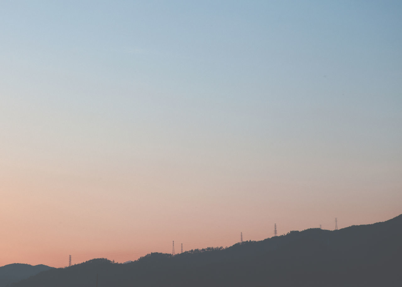 sunset, silhouette, mountain, nature, no people, beauty in nature, scenics, tranquil scene, tranquility, outdoors, sky, fuel and power generation, mountain range, landscape, technology, tree, wind turbine, wind power, windmill, industrial windmill, day