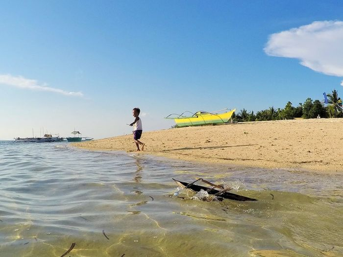 boy and toy boat Beach Beauty In Nature Boats⛵️ Boy Kids Being Kids Kids Having Fun Outdoor Photography Outdoors Real People Sea And Sky Toys Live For The Story