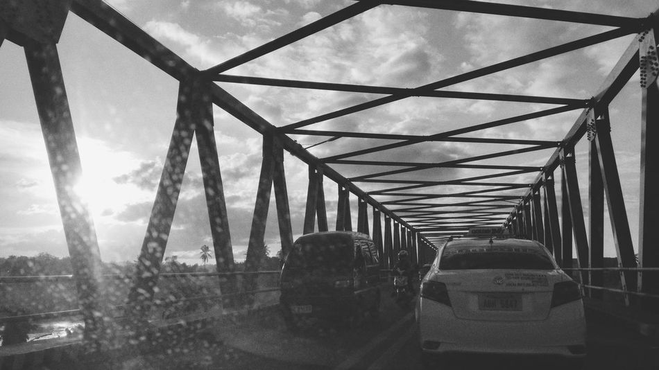 Going home Sky Day Outdoors Bridge - Man Made Structure Architecture Sculpture Arts Culture And Entertainment EyeEm Travel Photography Black & White Photography Black And White Collection  Eyeem Philippines Lines And Patterns EyeemPhilippines Geometric Architecture Built Structure EyeEm Best Shot S - Sunsets + Sunrise Passenger Cloud - Sky Travel Destinations