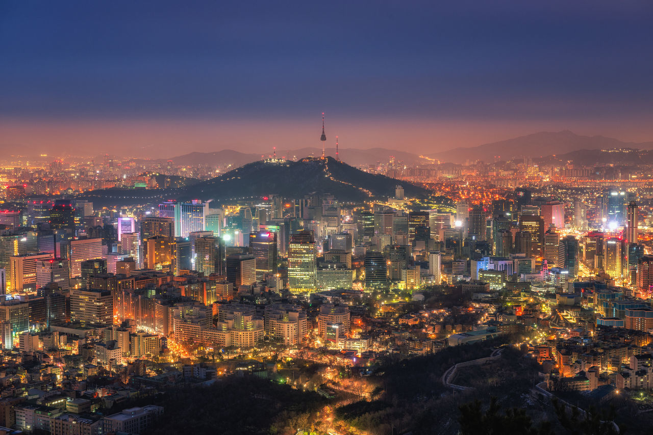 Korea,Seoul city and namsan tower at night Business; Central; South; Night; Scenery; Architecture Building Exterior Built Structure City Cityscape Crowded High Angle View Illuminated Korea; Seoul; Tower; Keywords; Travel; View; Inwangsan Modern Mountain Night Outdoors Sky Skyscraper Sunset Travel Destinations Urban Skyline