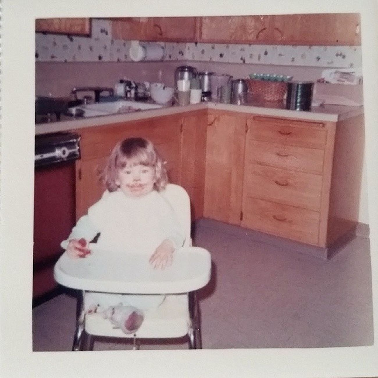 Little baby Kristen, enjoying a chocolate chip cookie, in my grandma's kitchen. ~1968 Chocolatewasted