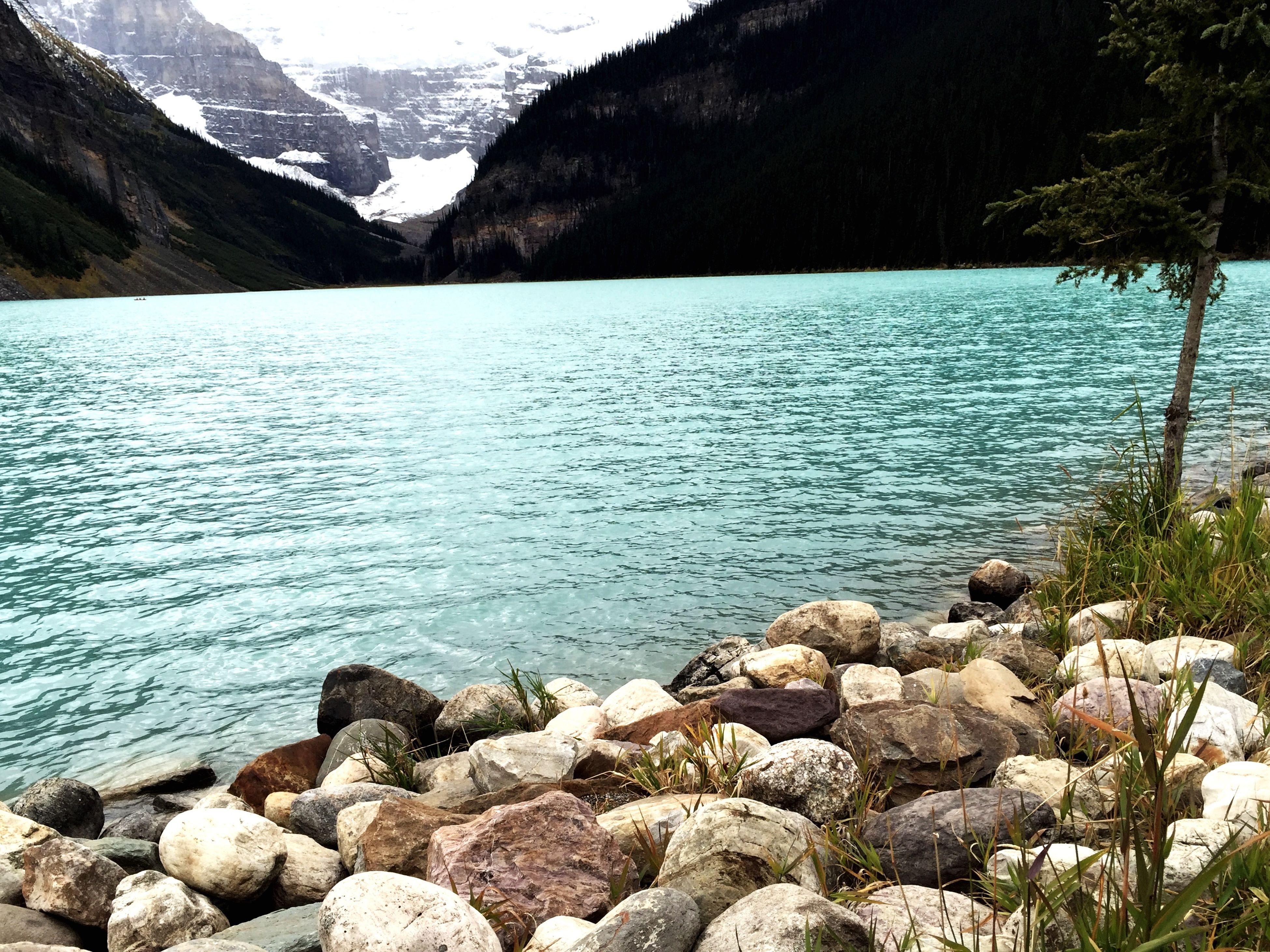water, mountain, tranquil scene, tranquility, scenics, beauty in nature, lake, nature, rock - object, mountain range, idyllic, sky, stone - object, rock, non-urban scene, rippled, river, remote, day, non urban scene