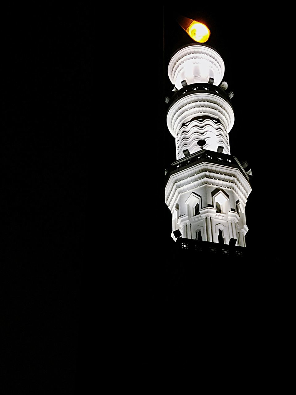 Low Angel View Of Illuminated Tower At Night