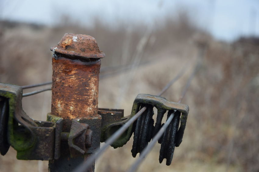 Railway Post Metal Wire Rusty Metal Close-up Focus On Foreground Soft Focus Blury Background Railway Track