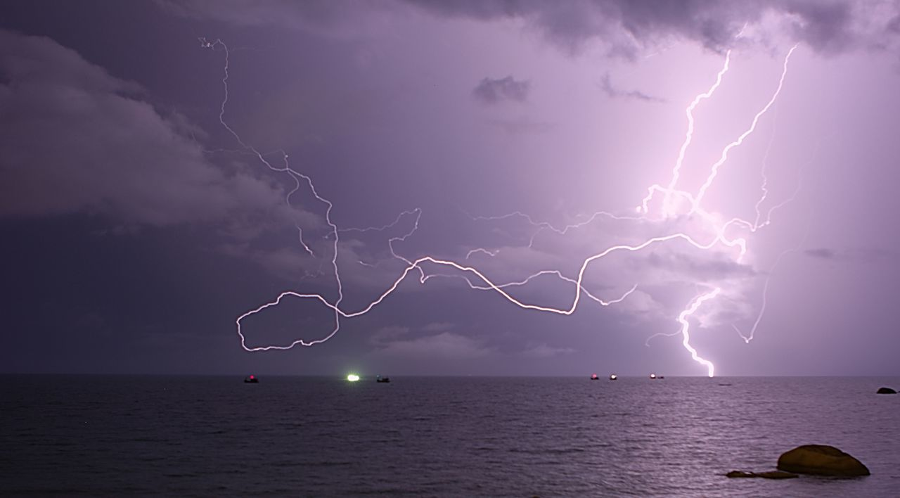 lightning, thunderstorm, storm, forked lightning, power in nature, weather, dramatic sky, storm cloud, nature, beauty in nature, danger, sea, cloud - sky, sky, scenics, atmospheric mood, horizon over water, night, water, outdoors, illuminated, no people, electricity, extreme weather