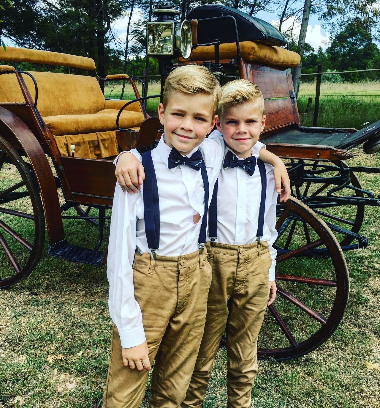 Boys Casual Clothing Childhood Day Front View Happiness Land Vehicle Looking At Camera Mode Of Transport Outdoors Portrait Real People Sibling Smiling Togetherness Transportation Two People