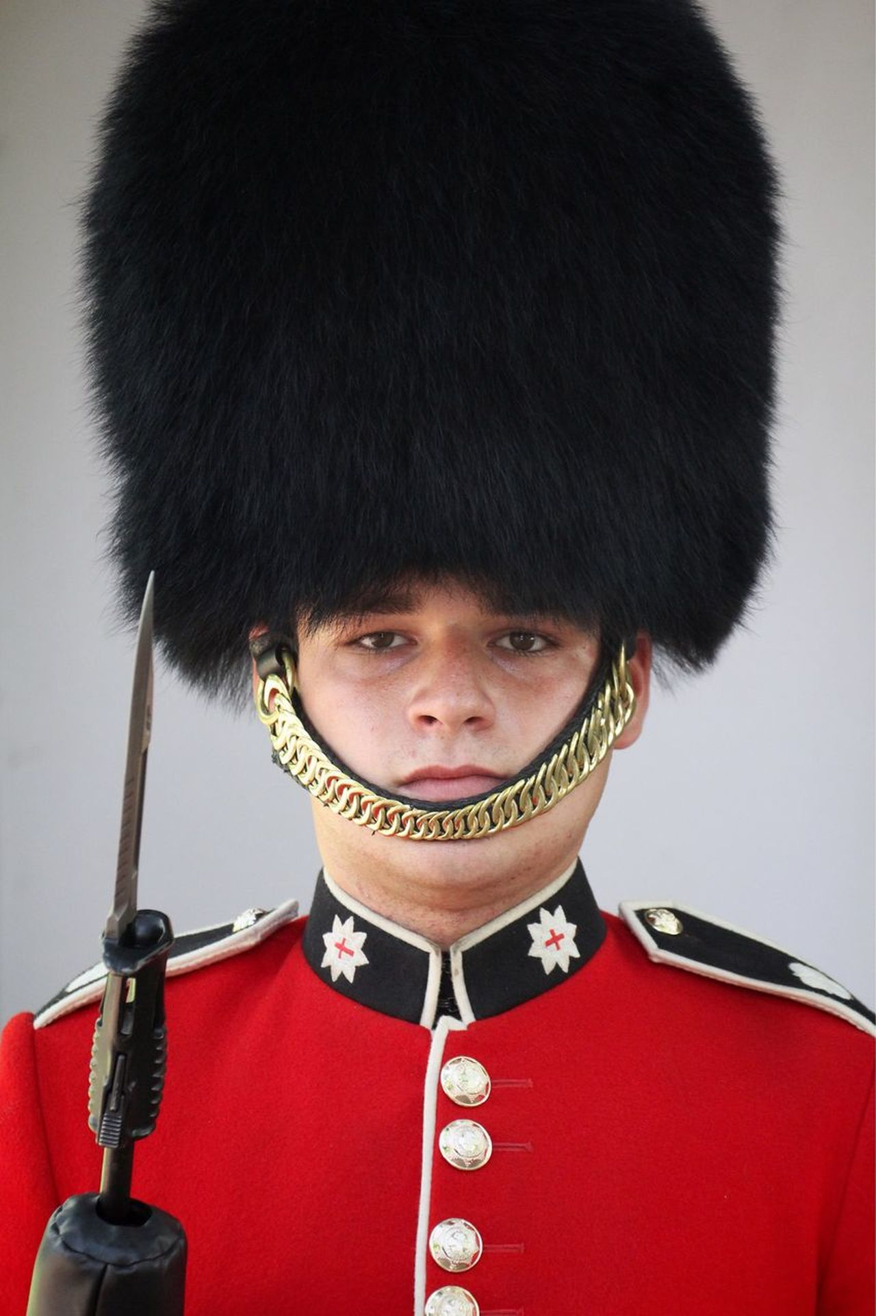 Man Guard Soldier Queen's Guard Uniform Sword Traditional Clothing One Person Portrait People Indoors  Period Costume Warrior - Person Cultures Kilt Headshot EyeEm Best Shots Check This Out Hat Weapon Gun Fur in Buckingham Palace London , United Kingdom