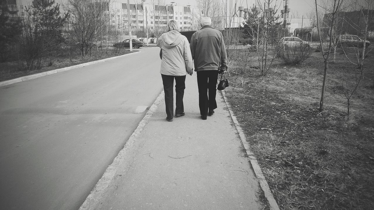 two people, walking, senior adult, full length, togetherness, senior men, real people, rear view, senior women, men, leisure activity, outdoors, day, lifestyles, senior couple, women, building exterior, built structure, bonding, friendship, architecture, tree, city, nature, adult, people, adults only