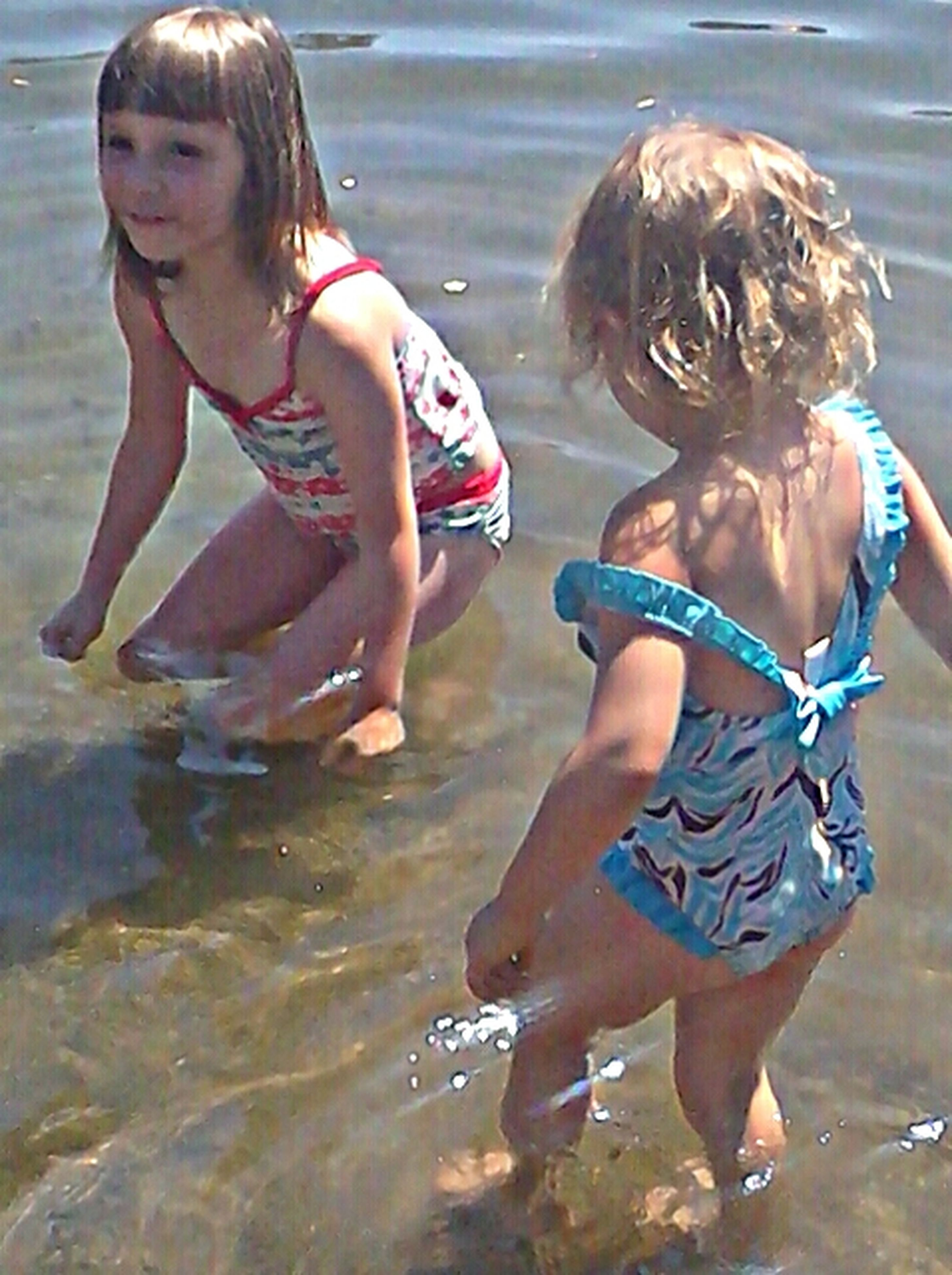 water, leisure activity, childhood, lifestyles, togetherness, person, enjoyment, fun, elementary age, girls, playful, full length, happiness, boys, bonding, beach, vacations