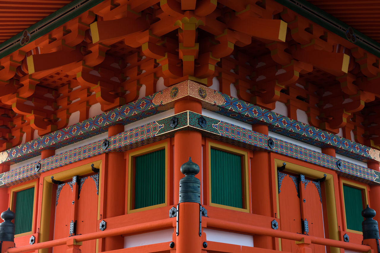 The colourful hues of a Japanese temple, complete with ornate finishes, and intricate wooden beams and patterns. Ancient Ancient Architecture Architecture Asian Culture Bright Colors Building Exterior Colour Of Life Culture Culture Of Japan Doors Green Color Japan Kyoto Symmetry Temple Wooden