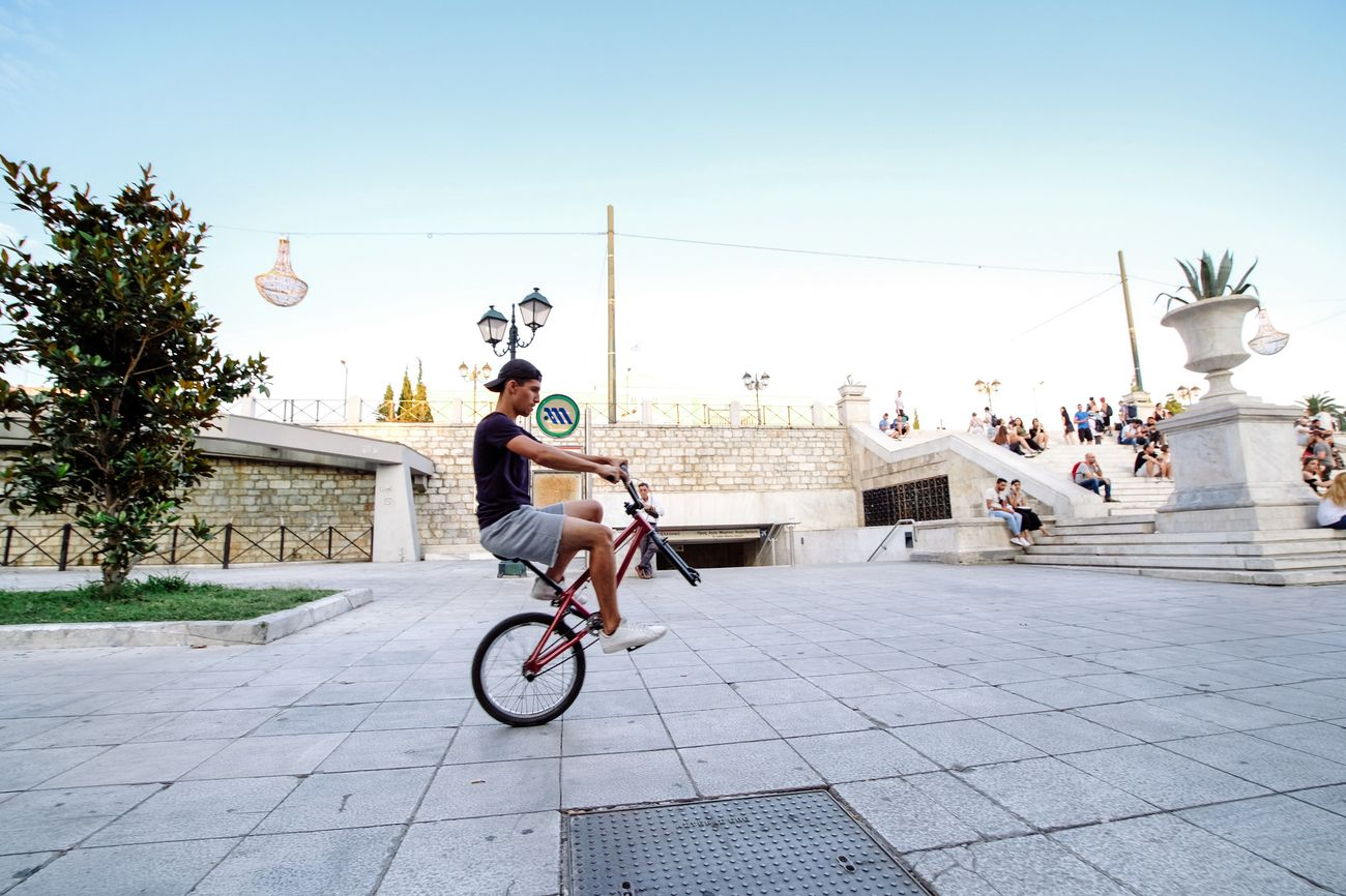 Cityscape Bicycle Cycling Riding Bmx Cycling Stunt City Outdoors Full Length City Life Leisure Activity Clear Sky Young Adult Building Exterior Greece Athens, Greece EyeEm Gallery Fujifilm Fujifilm_xseries The Week On EyeEem EyeEmBestPics Motion EyeEm Best Edits Lifestyles EyeEm Best Shots