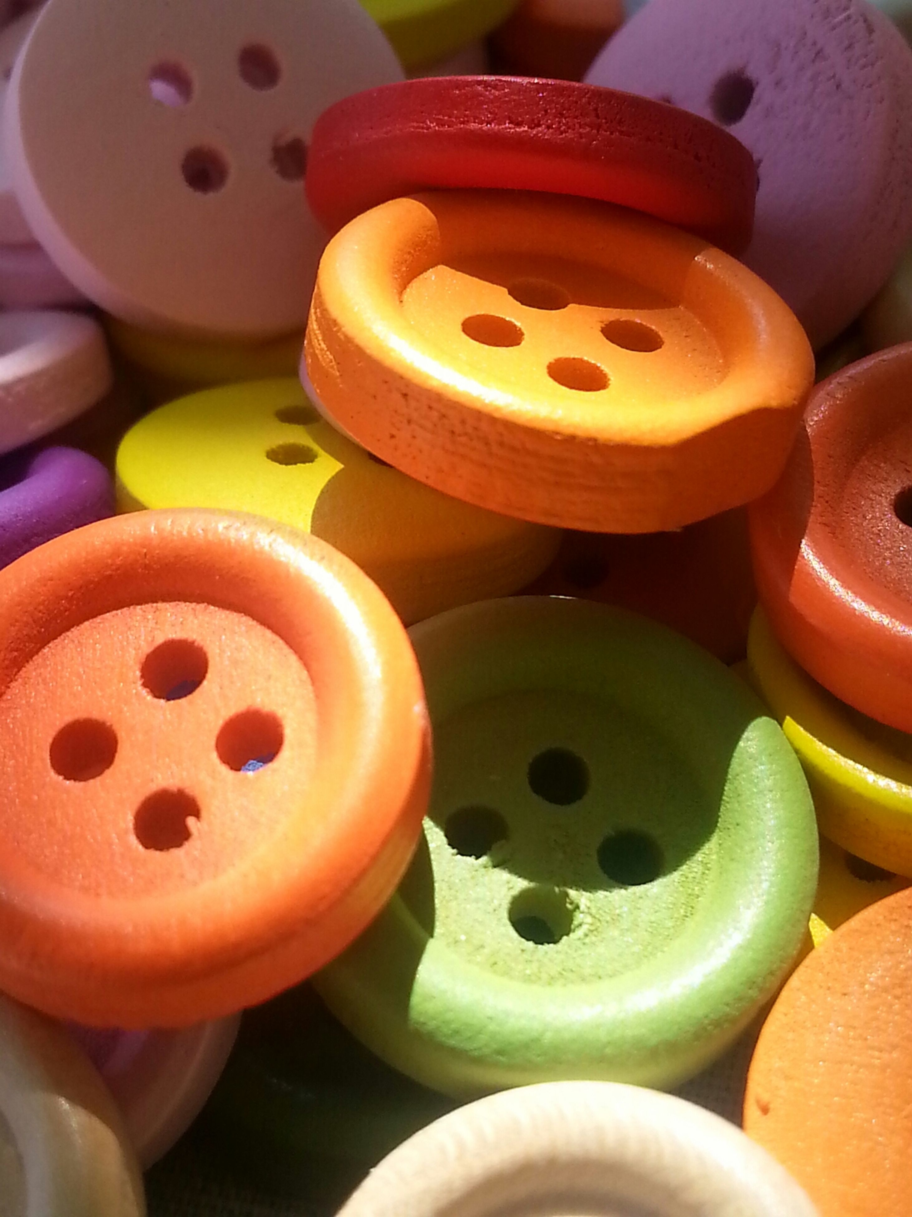 indoors, multi colored, large group of objects, variation, abundance, still life, close-up, choice, colorful, circle, high angle view, toy, red, arrangement, no people, childhood, collection, group of objects, stack, plastic