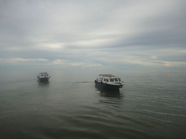 Sea trucks standing by. Boat River Sea Open Water Kalimantan Timur INDONESIA