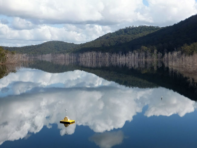 The upper intake of the Hinze dam on the Gold Coast Australia. Beauty In Nature Cloud - Sky Day Lake Mountain Mountain Range Nature No People Outdoors Reflection Scenics Sky Tranquil Scene Tranquility Tree Water