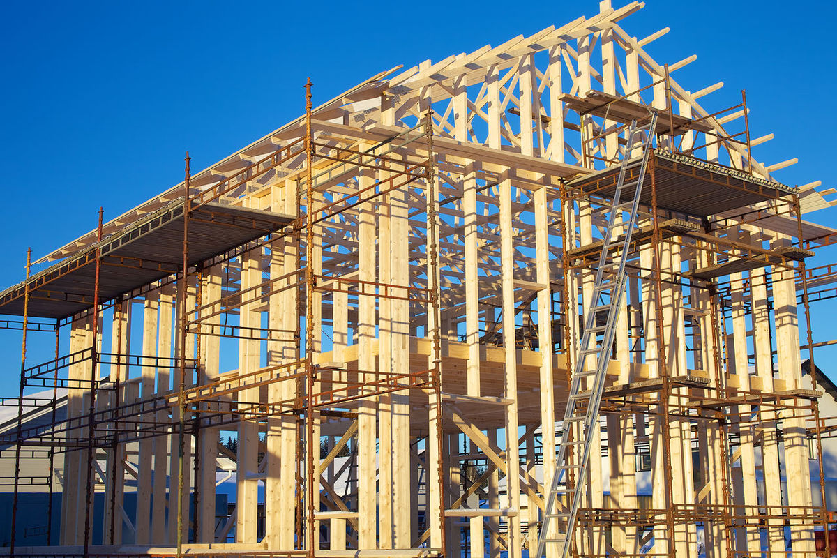 Home building construction site on sunny day. Building Industry Business Finance And Industry Construction Constuction Site Day House Building Industry Metal Industry No People Outdoors Plank Sky Sunny Under Construction Wood Wood - Material