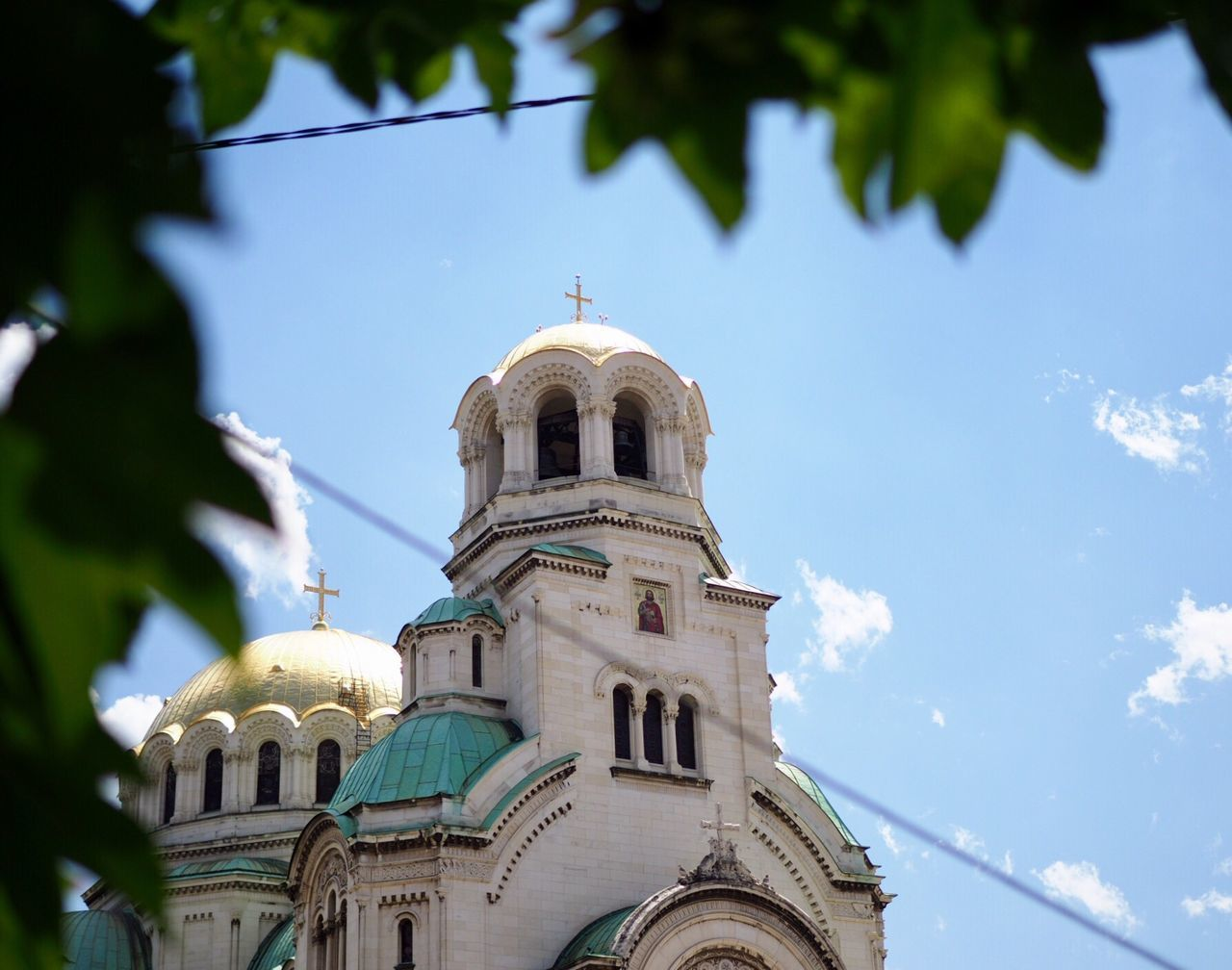 religion, place of worship, spirituality, architecture, dome, built structure, low angle view, building exterior, day, sky, cross, outdoors, history, no people, bell, bell tower