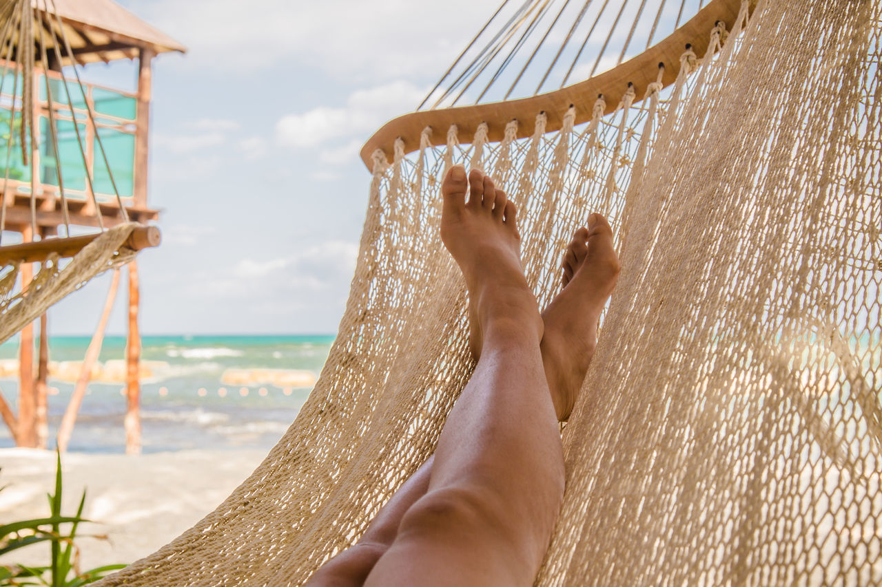 Legs of a young woman relaxing in a hammock on a beach # #dream #JustMe #lazyday #sunset #sun #clouds #skylovers #sky #nature #beautifulinnature #naturalbeauty #photography #landscape #TBT Adult Barefoot Beach Close-up Day Human Body Part Human Leg Leisure Activity Lifestyles Low Section Nature One Person Outdoors People Real People Sea Sky Vacations Water