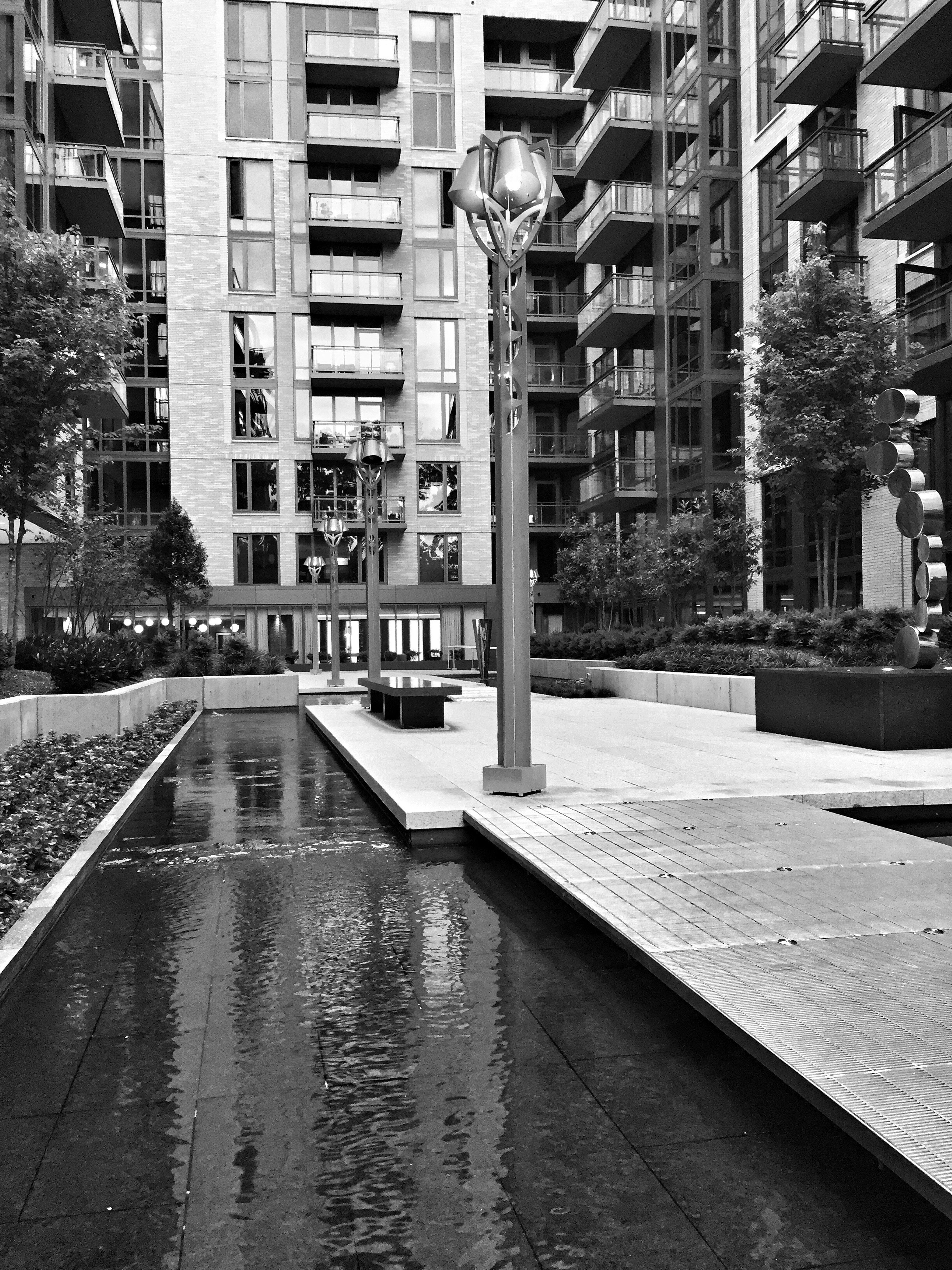 Building Exterior Built Structure Architecture City Water Residential Structure Travel Destinations Reflection IPhoneography Black & White Monochrome Architecture Canal City Life Apartment City Street Tower Residential District Skyscraper Waterfront Modern Building Story Tall - High Outdoors
