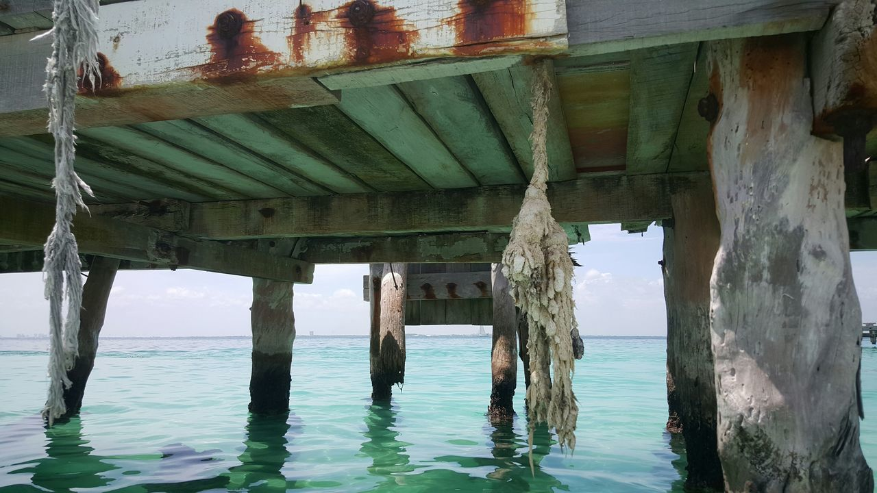 Close-Up Of Abandoned Wooden Pier In Sea