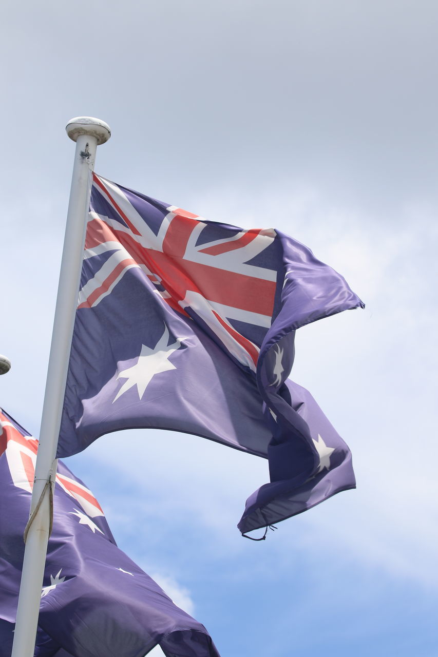 Low Angle View Of Australia Flag Against Cloudy Sky