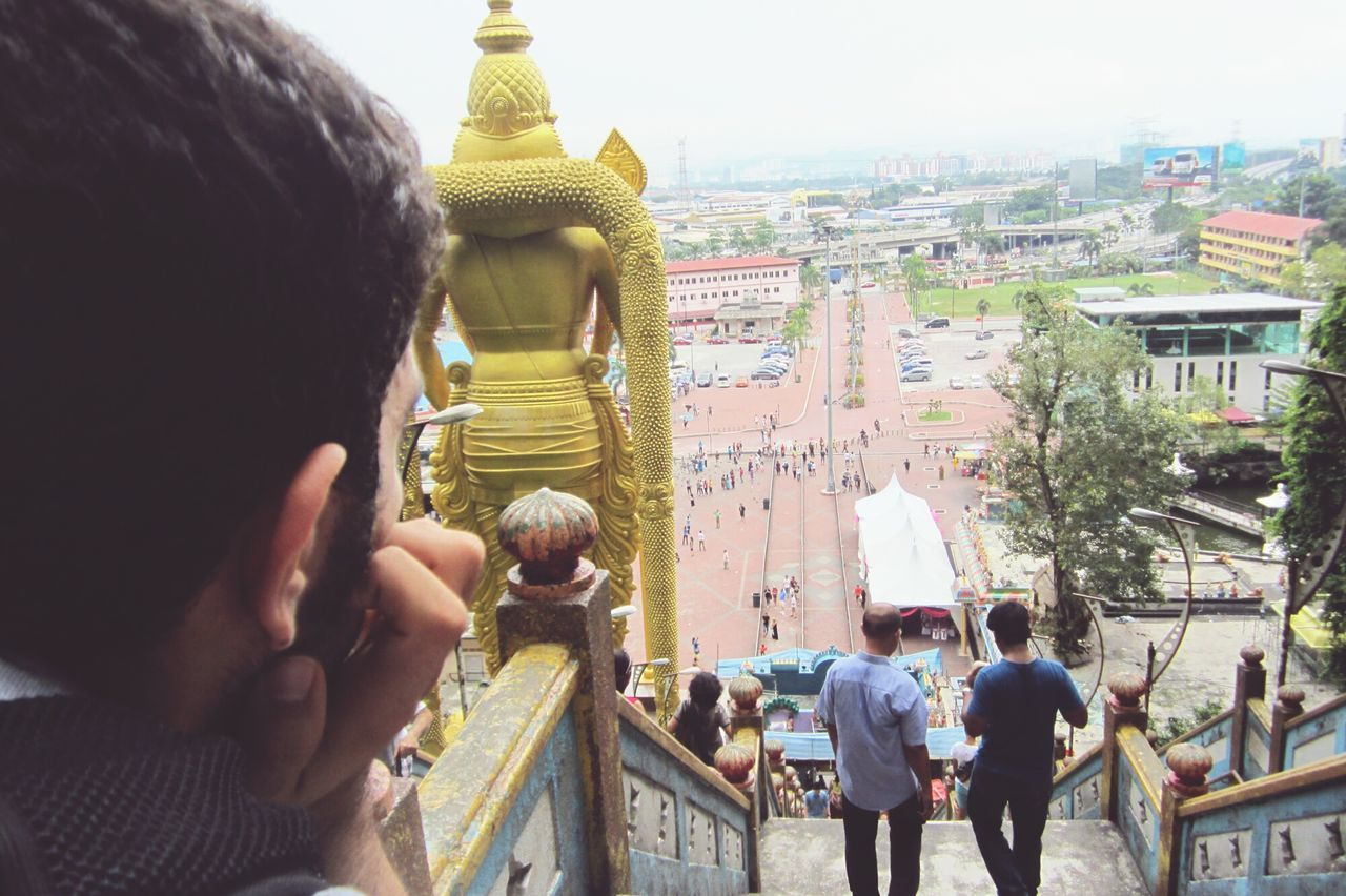 Travel Destinations Religion Architecture Built Structure Place Of Worship Travel Tourism City Gold Colored Adults Only Building Exterior People Spirituality Men Outdoors Sky Adult Day Kuala Lumpur Malaysia  Batu Caves -Malaysia Meditation Dreaming Thinking EyeEmNewHere
