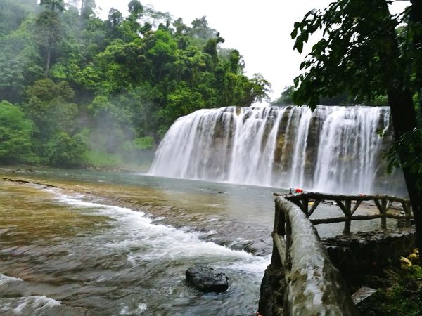Tinuy-an Falls, Surigao del Sur, Philippines. Waterfall Water Tourism Scenics Nature Travel Travel Destinations Outdoors Beauty In Nature Day Beauty Landscape Nature Photography Waters Waterfalls Waterfalls And Calming Views  Waterscape Waterfalls In Philippines Waterfall Photography Tinuy-an Falls Surigao Del Sur Philippines