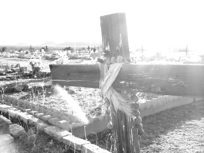 Black And White Cemetery Cemetery_shots Chloride Arizona Cold Temperature Ghost Town Graveyard Beauty Human Settlement Lens Flare Monochrome Old Wooden Cross Sunbeam Tombstone Winter