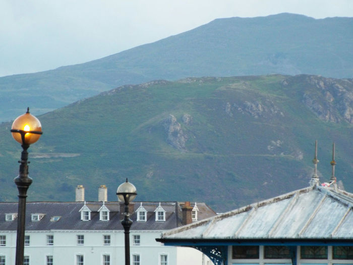 View of the Welsh mountains from Llandudno Pier Built Structure Architecture Building Exterior No People Sky Outdoors Dome Mountain Nature Day Pier Wales, UK Wales Wales UK Llandudno Pier Travel Destinations