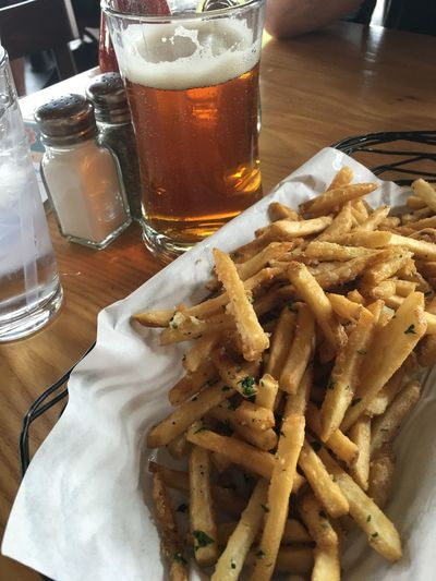 Beer and Garlic Fries Beer - Alcohol Beer Glass Close-up Day Drink Drinking Glass Food Food And Drink French Fries Freshness Frothy Drink Indoors  No People Plate Prepared Potato Ready-to-eat Serving Size Table Unhealthy Eating