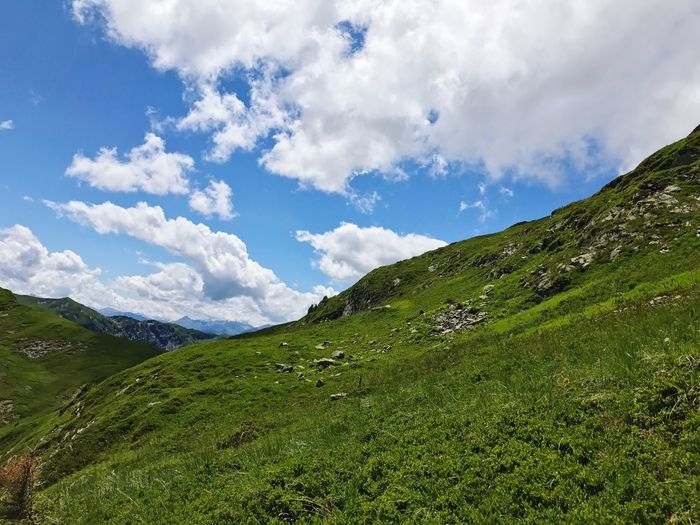 Alps Mountain Sky Cloud - Sky Beauty In Nature Nature Scenics Green Color Day Grass Tranquil Scene Tranquility Outdoors No People Landscape Mountain Range