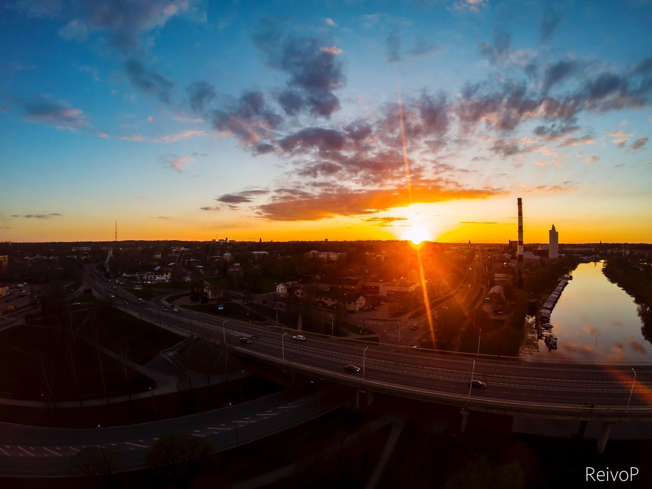 sunset, sky, sun, transportation, architecture, bridge - man made structure, built structure, connection, high angle view, cloud - sky, city, no people, sunlight, outdoors, road, building exterior, cityscape, nature, day