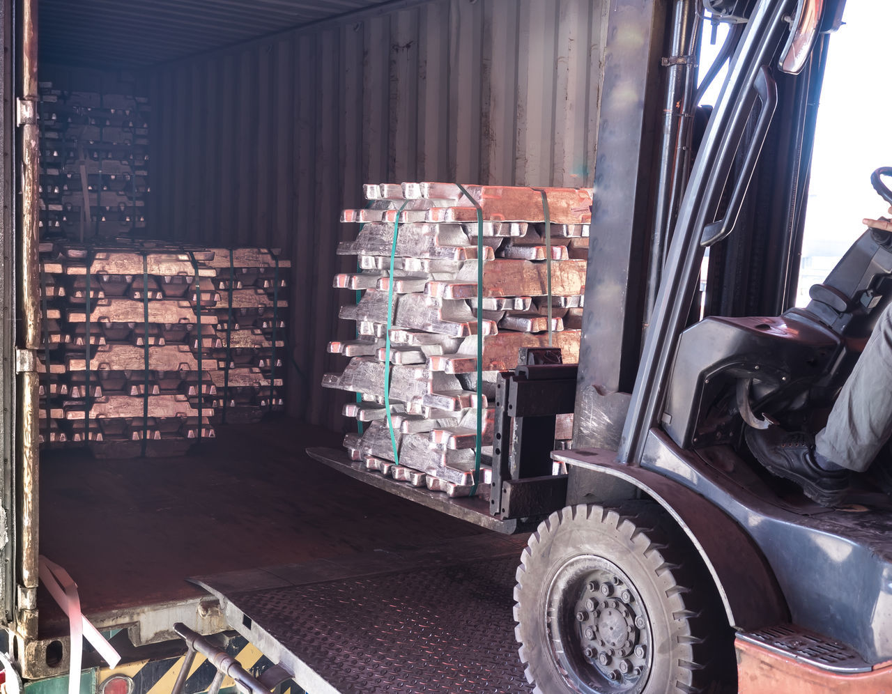 Unstuffing aluminium ingot from container Zinc Stack Business Finance And Industry Large Group Of Objects Abundance Warehouse Day Transportation Industry No People Indoors  Metal Industry unstuff Container Metal Reflection Silver  Stock Storage Handling Forklift Crane closeup Blocks Aluminium Ingots Factory