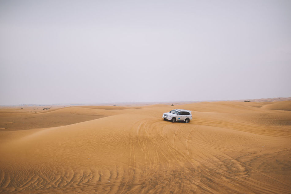 Adventure Arid Climate Beauty In Nature Car Clear Sky Day Desert Dubai Horizon Landscape Nature No People Outdoors Sand Sand Dune Scenics Sky Transportation Travel UAE United Arab Emirates