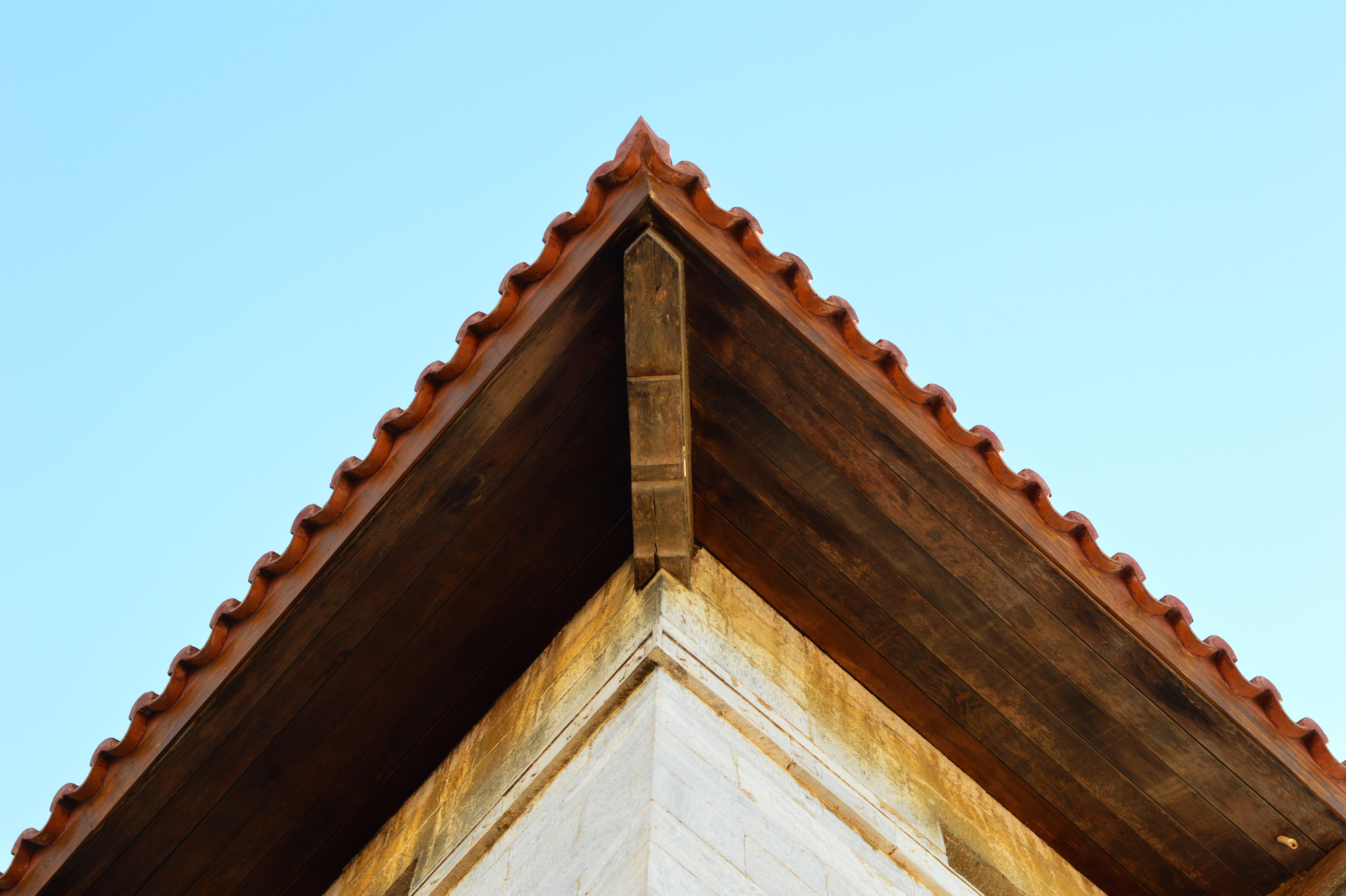 low angle view, architecture, built structure, building exterior, clear sky, day, roof, no people, outdoors, place of worship, sky