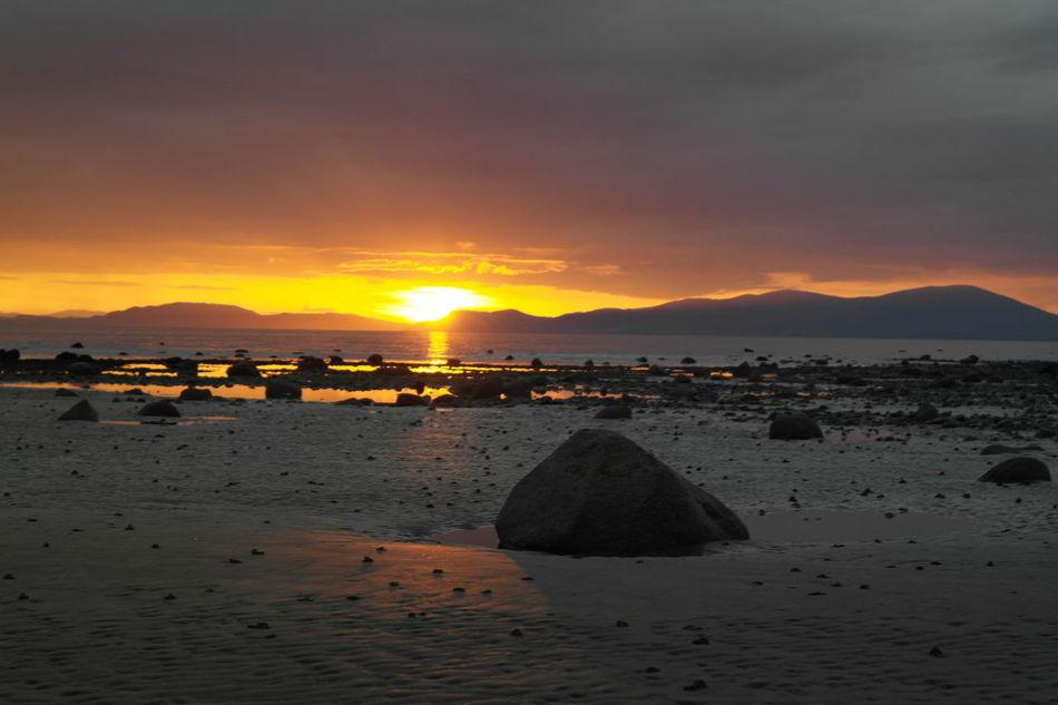 Sunset Beach Sand Rocks