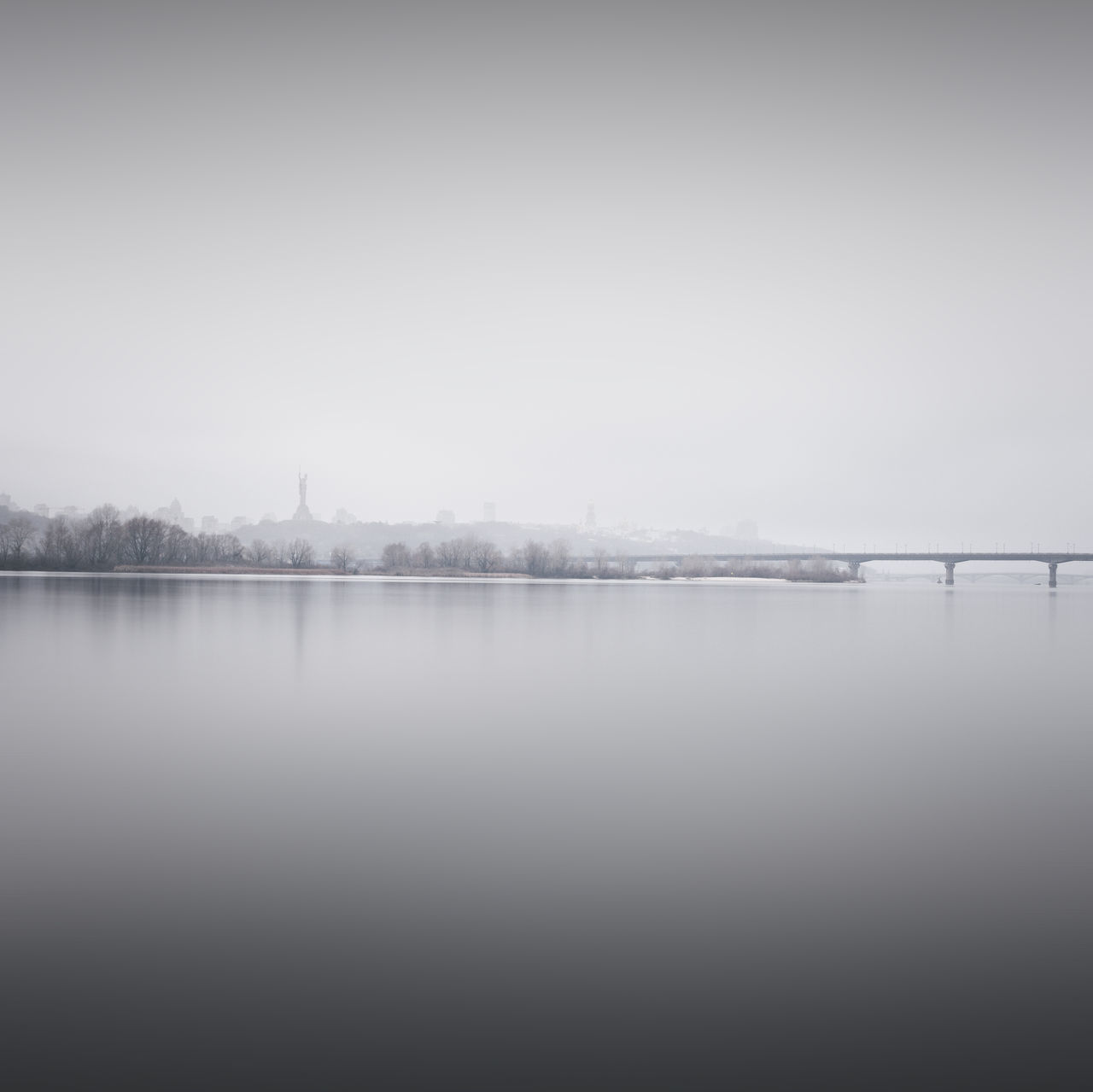 scenic view of river against sky during winter Beauty In Nature Cold Temperature Copy Space Day Fine Art Fog Kyiv Lake Landscape Long Exposure Muted Colors Nature No People Outdoors Philipp Dase River Scenics Sky Tranquil Scene Tranquility Ukraine Water Winter