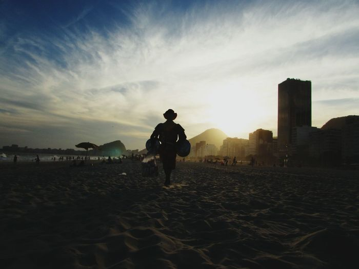 Praia do Leme, Rio de Janeiro Adults Only Outdoors Full Length One Person Only Men Rear View People Built Structure Real People Adult Sunset Day One Man Only Vacations City Sky