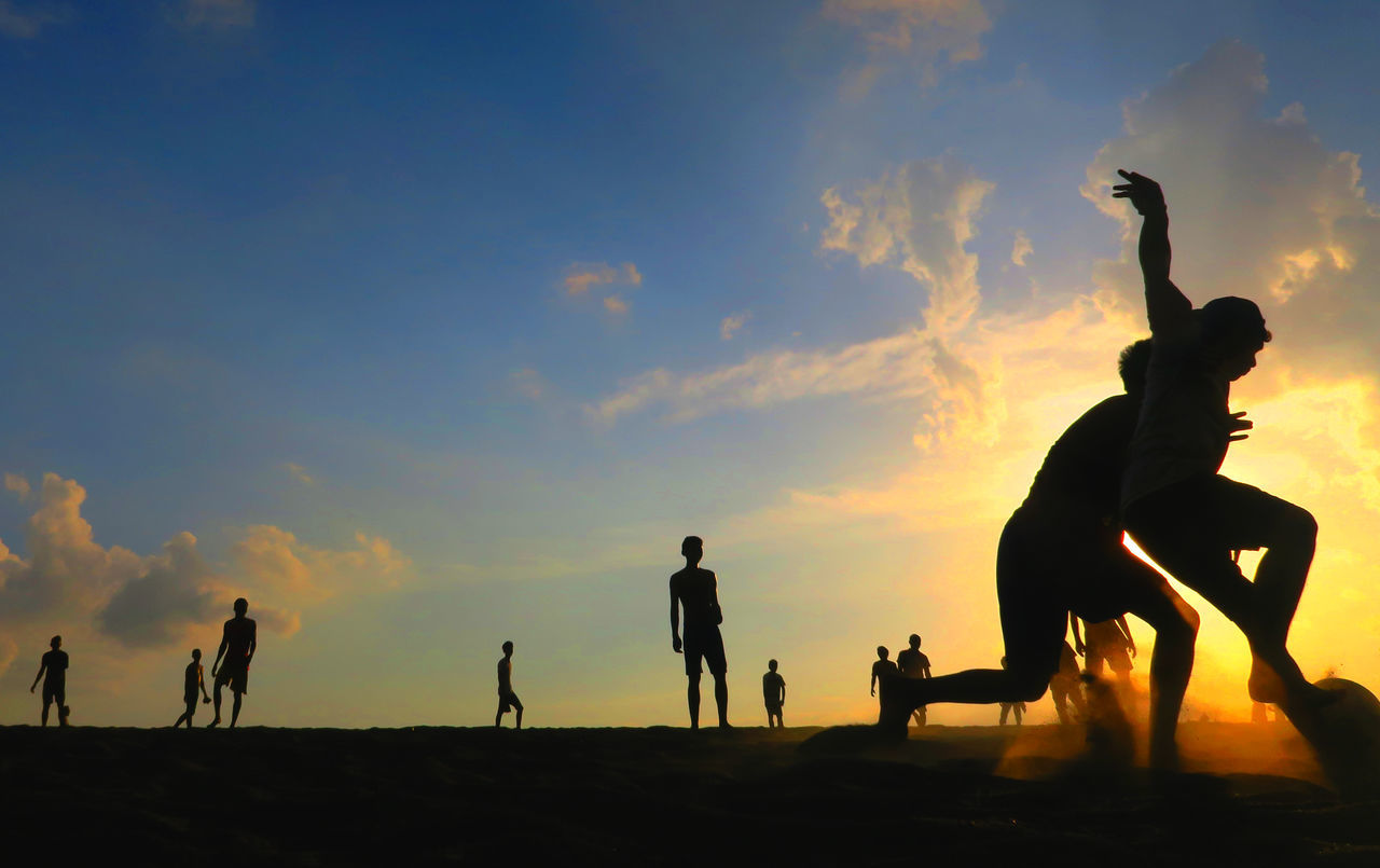sunset, silhouette, sky, men, lifestyles, real people, leisure activity, full length, outdoors, nature, beach, cloud - sky, scenics, standing, togetherness, beauty in nature, day, mammal, people
