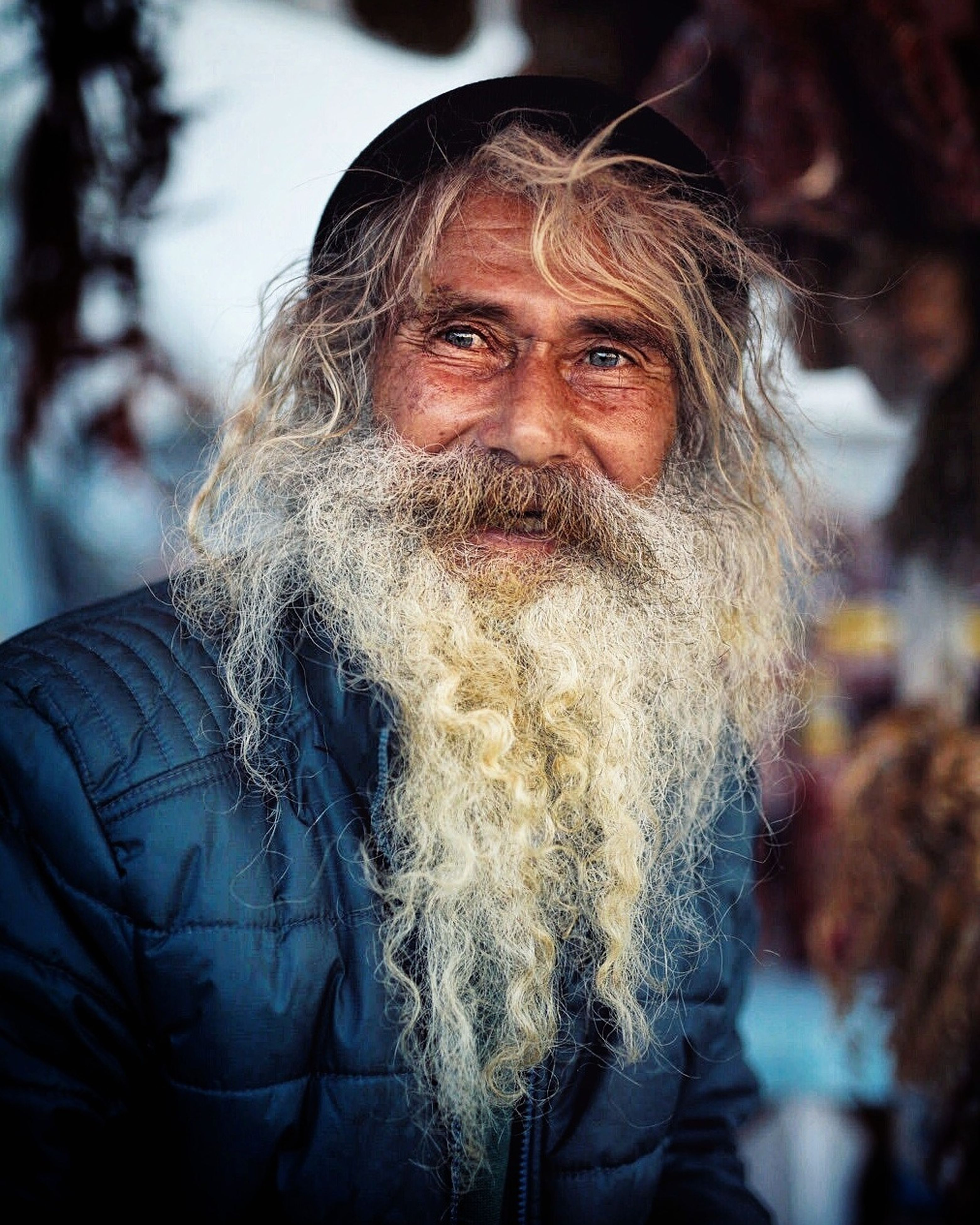 beard, real people, portrait, senior men, senior adult, looking at camera, one person, outdoors, focus on foreground, one senior man only, men, long hair, lifestyles, front view, mustache, close-up, cold temperature, one man only, city, day, only men, adult, people, adults only