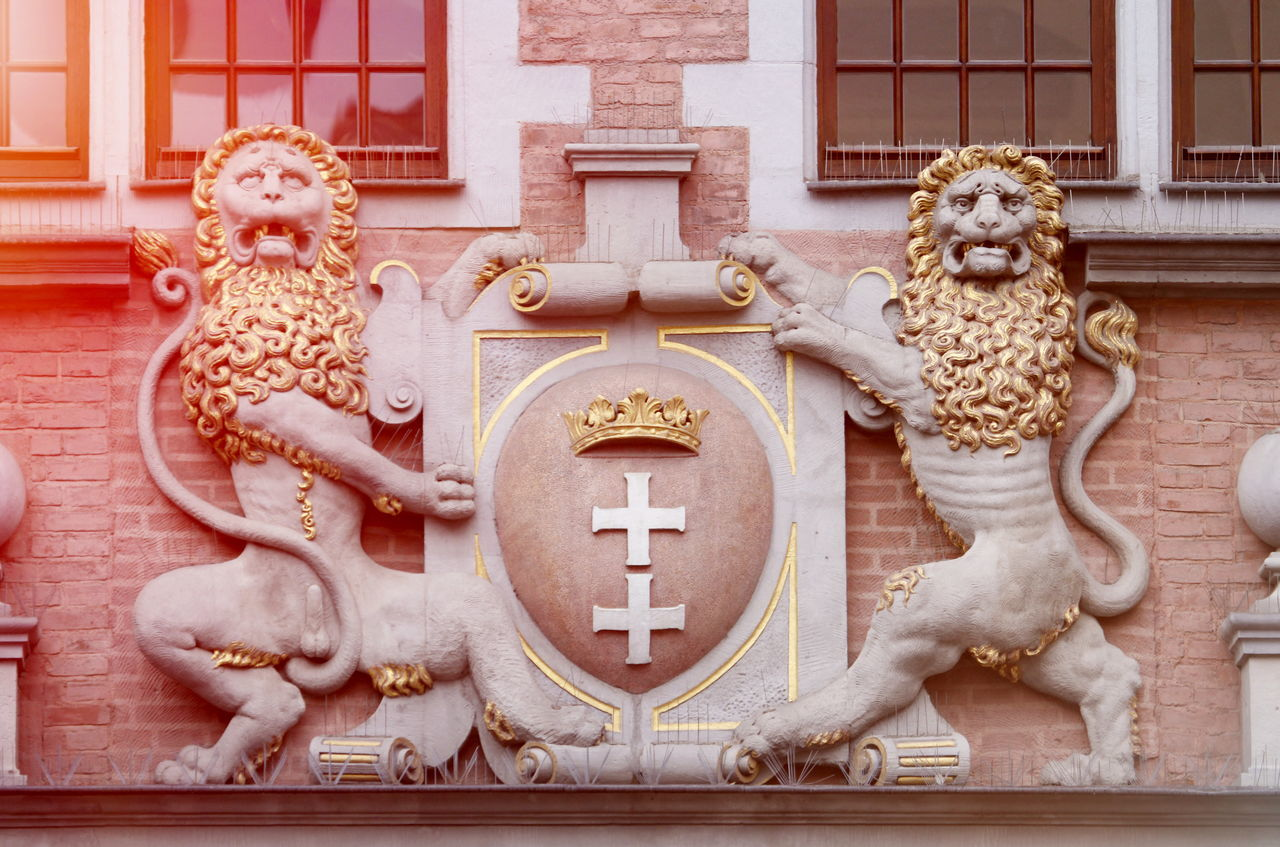 Architecture detail in Old Town in Gdansk Architecture Arms Building Close-up Day Destination Detail Gdansk Light Lion - Feline Lions No People Old Town Outdoors Sculpture Sun Symbol Travel Warm