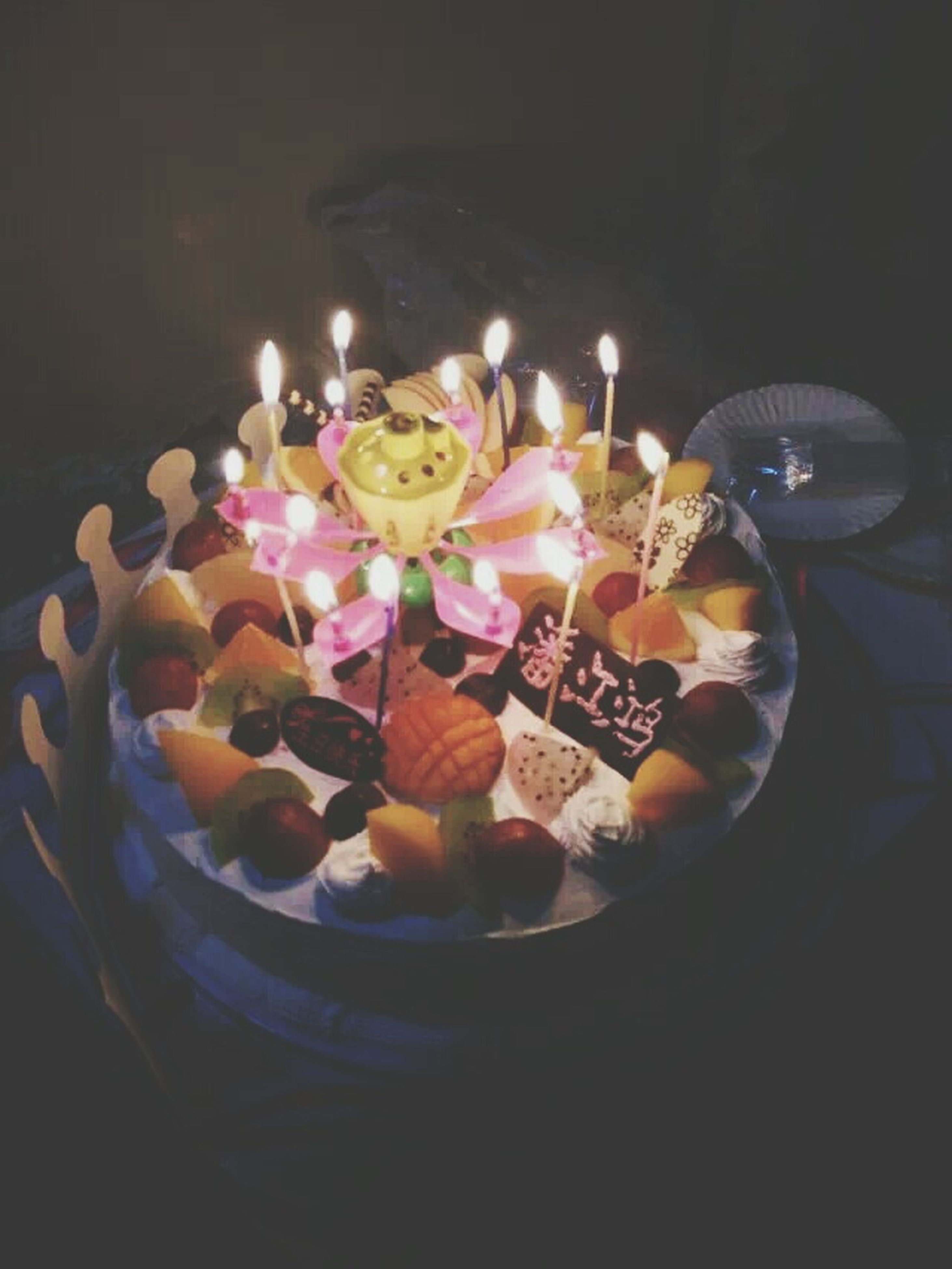 indoors, sweet food, celebration, multi colored, still life, illuminated, table, food and drink, decoration, food, high angle view, night, dessert, indulgence, freshness, candle, no people, close-up, art and craft, creativity