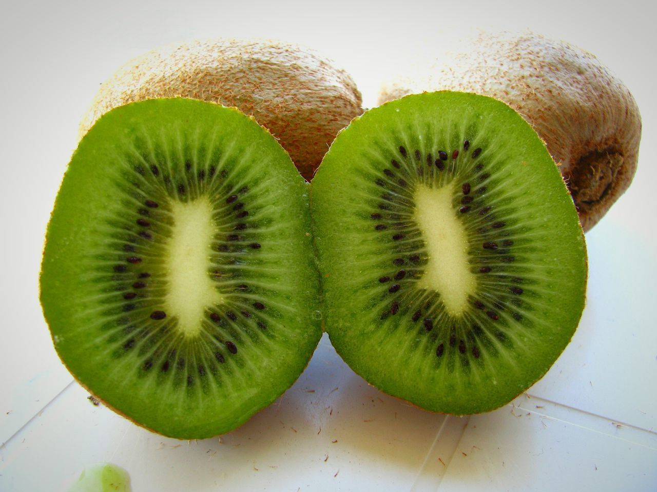 Kiwi Kiwi - Fruit Kiwis Fruit Green Color Backgrounds Fine Art Dietfood Diet & Fitness Diet Green Green Fruit Food Close-up Food And Drink Healthy Eating Freshness Ready-to-eat Nutritious Delicious Still Life White Background My World Of Food Food Photography Healthy Food Visual Feast