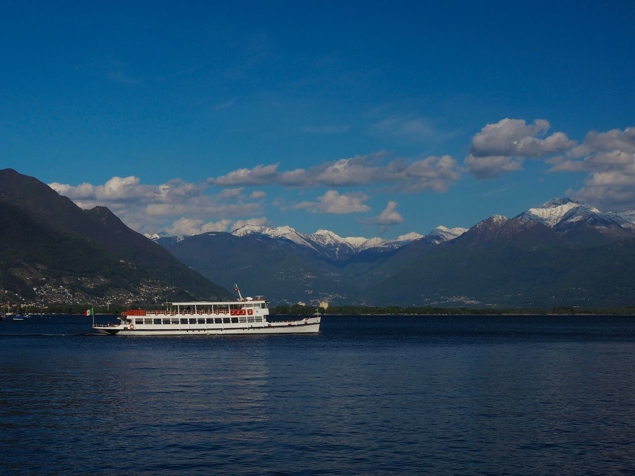 mountain, cloud - sky, sky, nature, scenics, water, beauty in nature, mountain range, transportation, nautical vessel, day, tranquility, outdoors, waterfront, mode of transport, tranquil scene, no people, lake