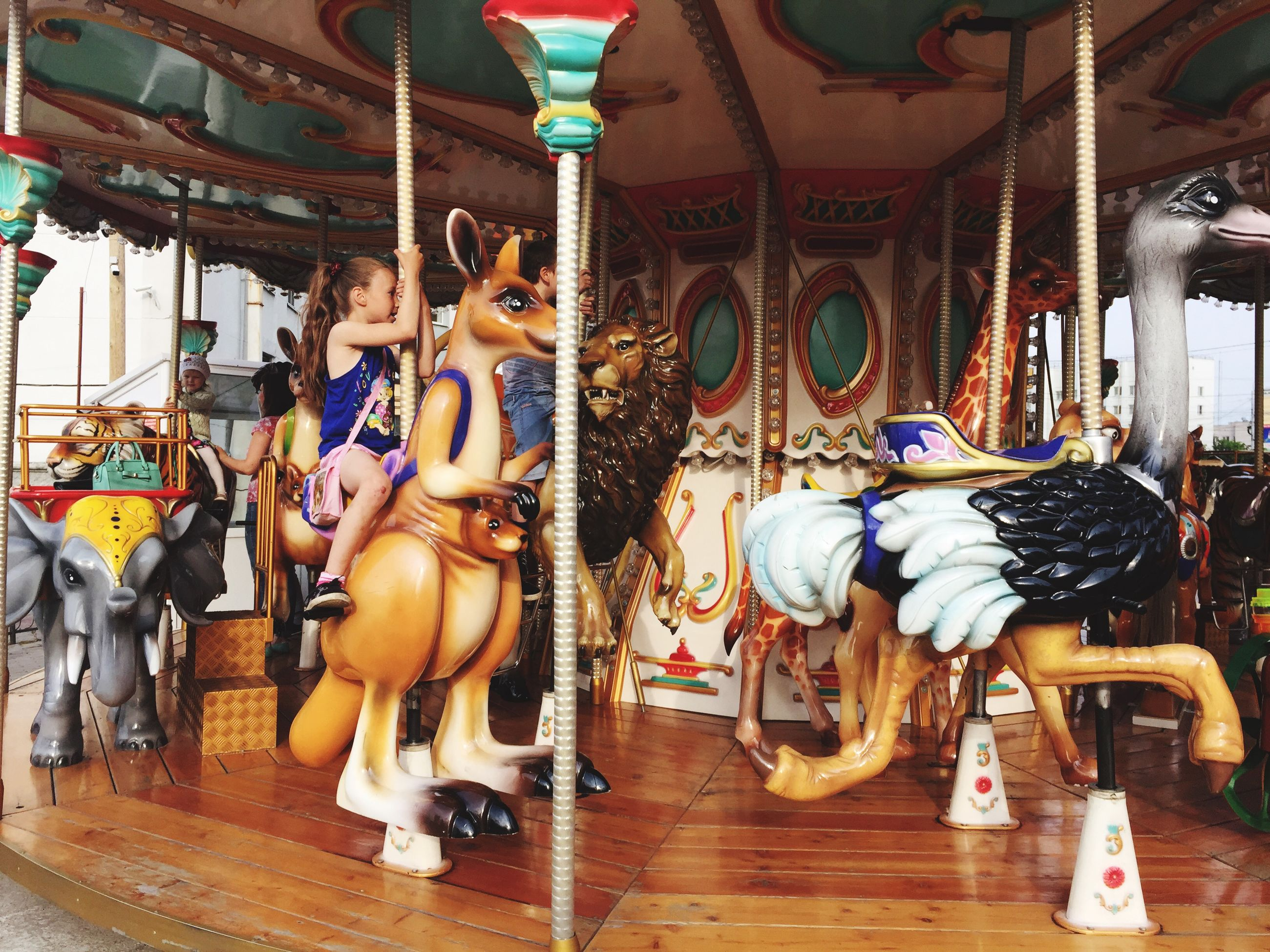 indoors, art and craft, art, animal representation, creativity, human representation, arts culture and entertainment, sculpture, carousel, statue, multi colored, amusement park, cultures, decoration, leisure activity, hanging, tradition