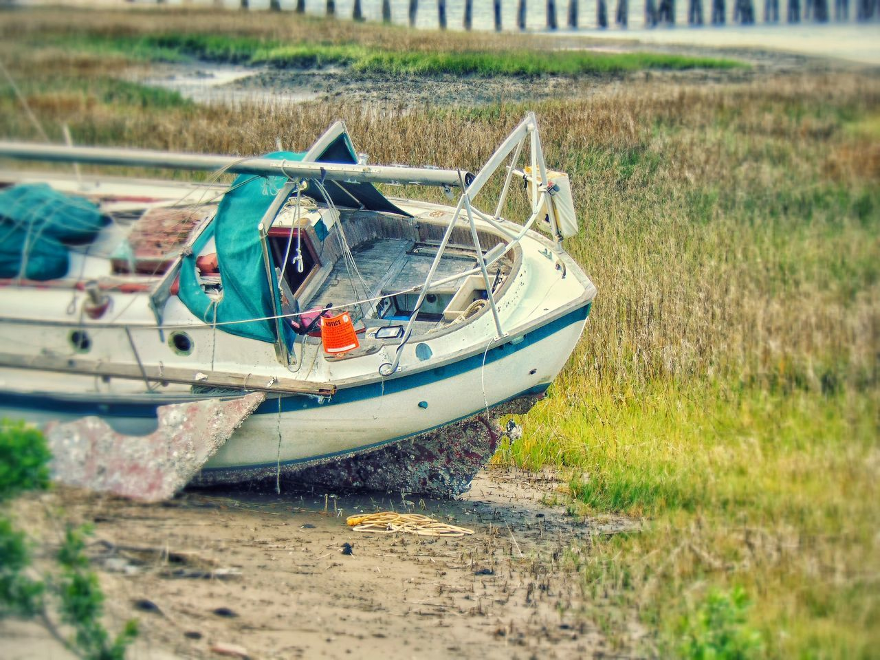 nautical vessel, transportation, boat, mode of transport, moored, water, day, outdoors, nature, beach, abandoned, no people, field, grass, sea, outrigger, beauty in nature, sky