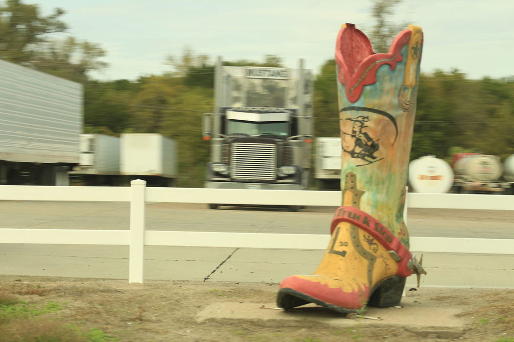 Big Boot Day Empty Road Focus On Foreground No People Outdoors Road Road Sign Roadside Attraction Travel Destinations