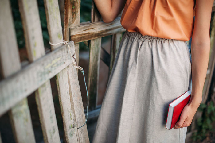 Book Casual Casual Clothing Fence Holding Old Person Red Book Shabby Standing Female Girl