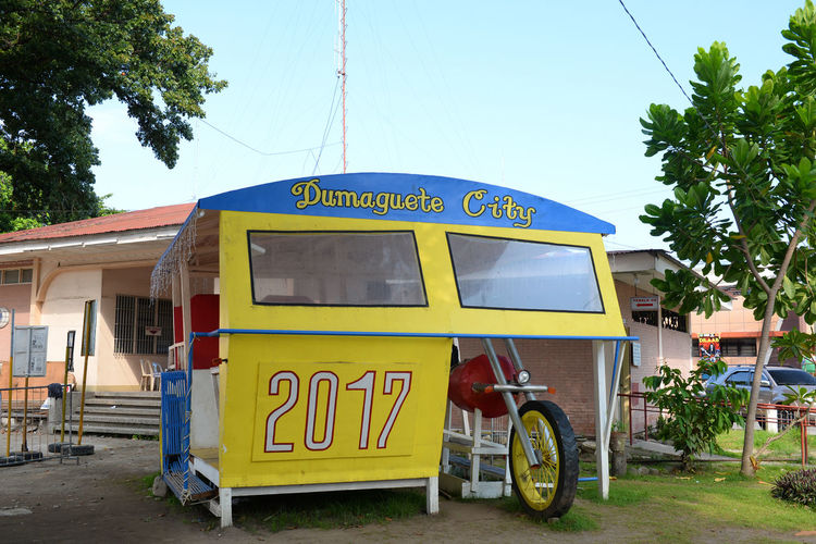 """Dumaguete's Trademark Tricycle. Locally called """"pedicab"""" Eyeem Philippines Day Land Vehicle Mode Of Transport No People Outdoors Sky Transportation Tree Yellow An Eye For Travel"""